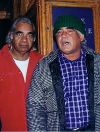 "Left: Bobby McLeod (1947 – 30 May 2009) was an Aboriginal activist, poet, healer, musician and Yuin elder. He was from Wreck Bay Village, Jervis Bay Territory. https://en.wikipedia.org/wiki/Bobby_McLeod Right: Kevin Daniel ""Kev"" Carmody (born 1946 in Cairns, Queensland) is an Indigenous Australian singer-songwriter. His song ""From Little Things Big Things Grow"" ...https://en.wikipedia.org/wiki/Kev_Carmody"