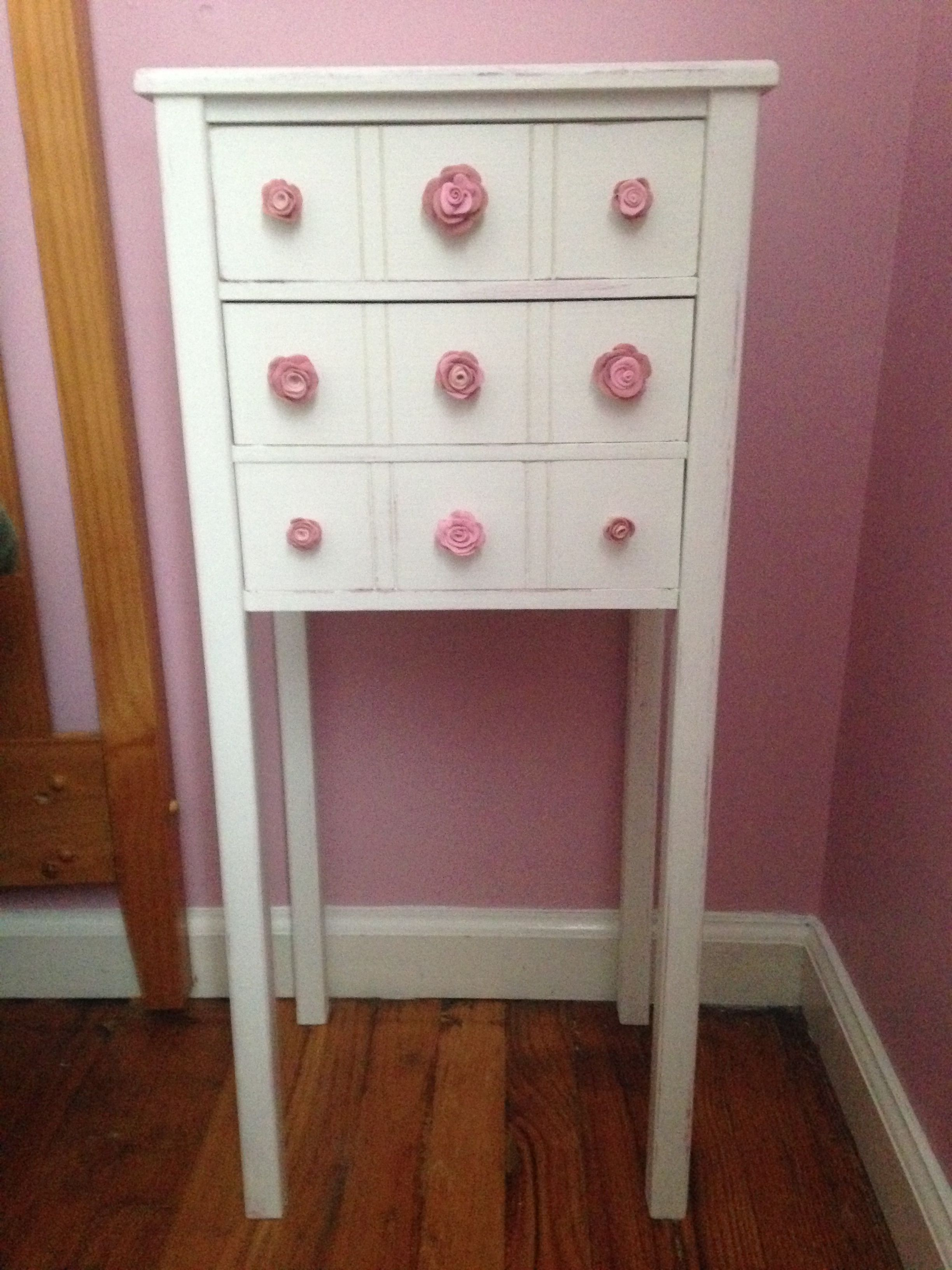 I repainted this stand and created the pull knobs from polymer clay!