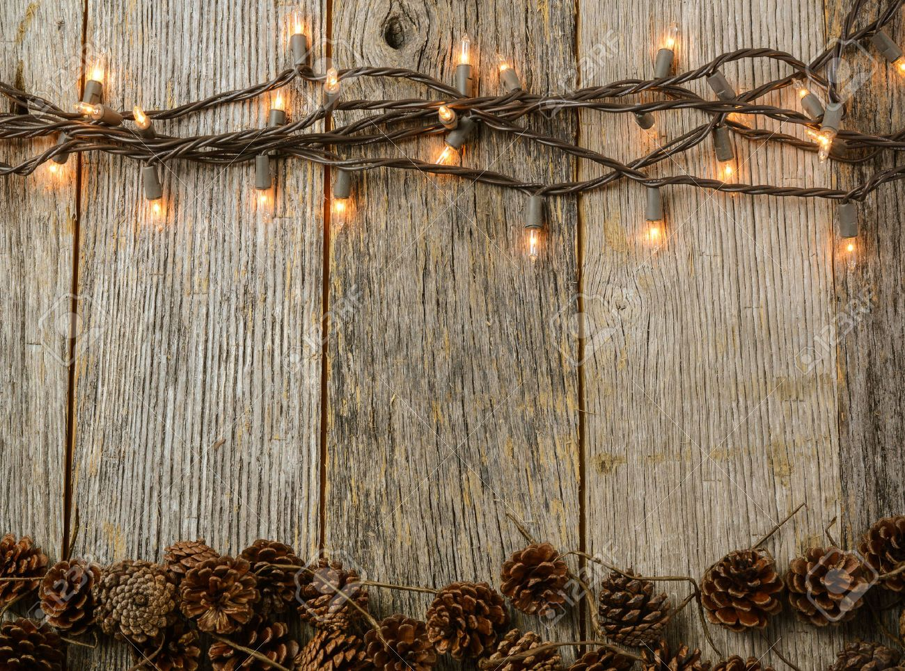 Fall String Lights Wallpaper Weddings Christmas Lights And Pine Cones On Rustic Wood Background
