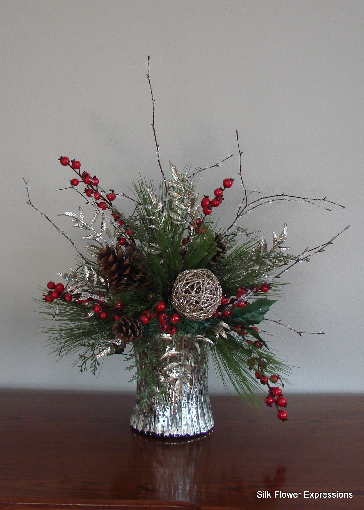 Silver And Red Holiday Arrangement Christmas Flower Arrangements Christmas Floral Arrangements Christmas Floral