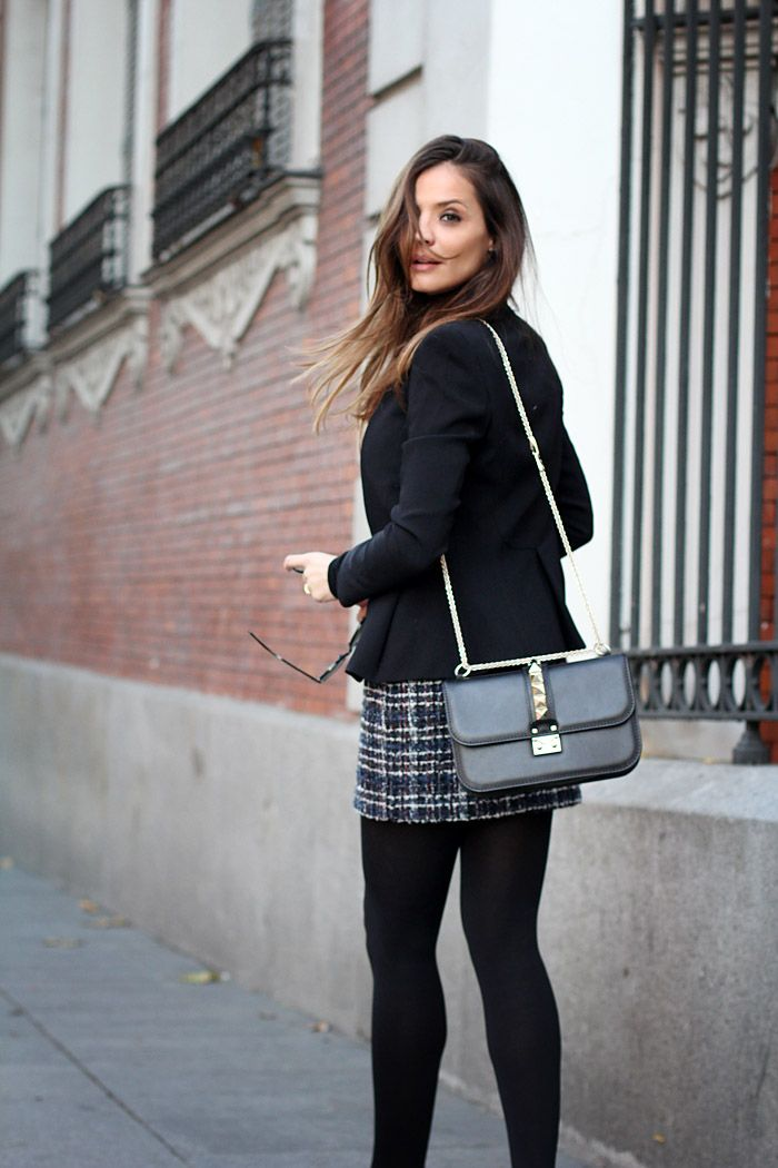 tweed mini skirt with a blazer, turtle neck jumper, black opaque tights and stiletto