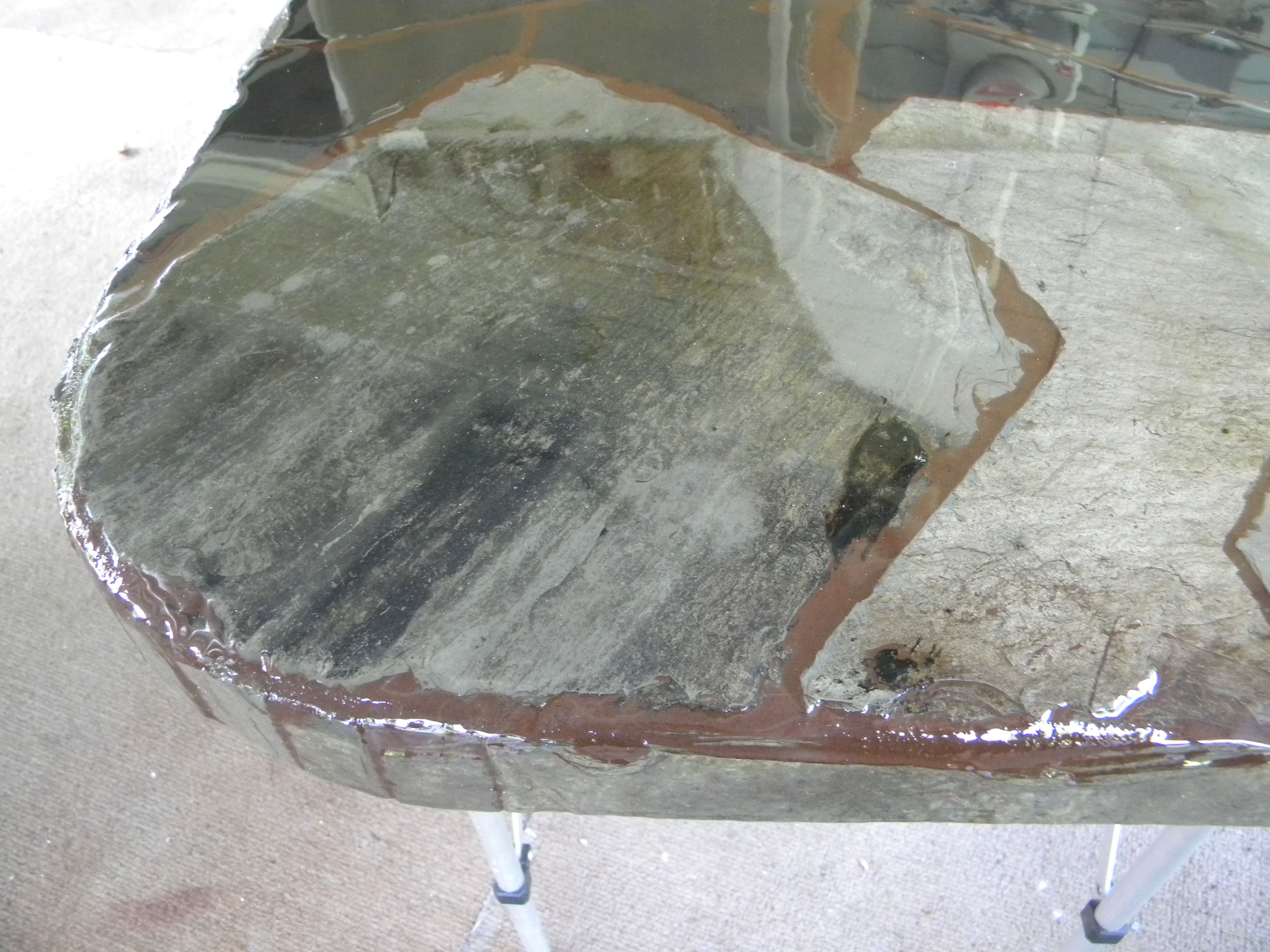 table top made out of old roof slate tile