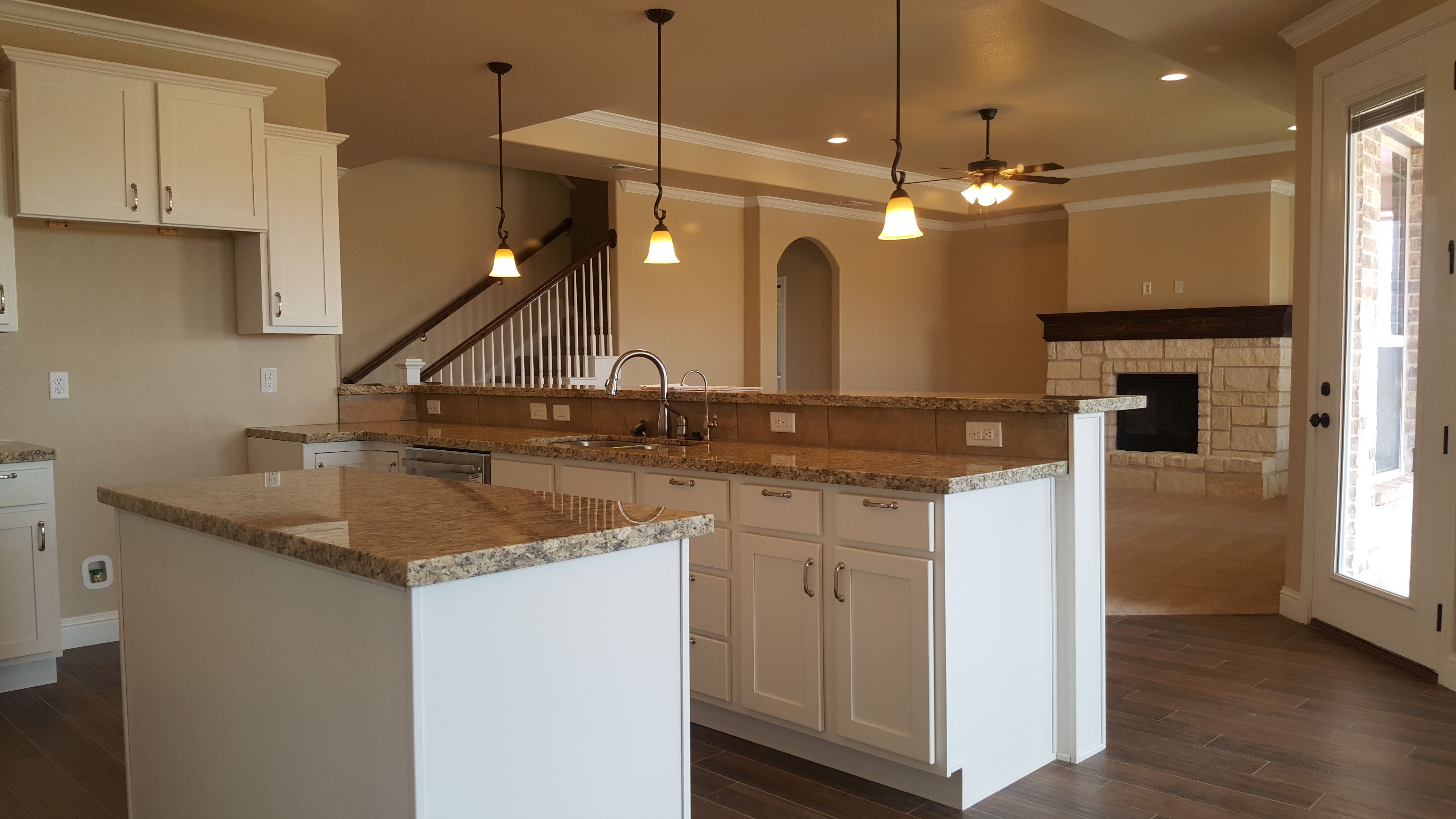 A Custom Kitchen Layout In The Giana Ivory Painted Cabinets New Venetian Gold Granite New Venetian Gold Granite Light Granite Countertops Light Wood Kitchens