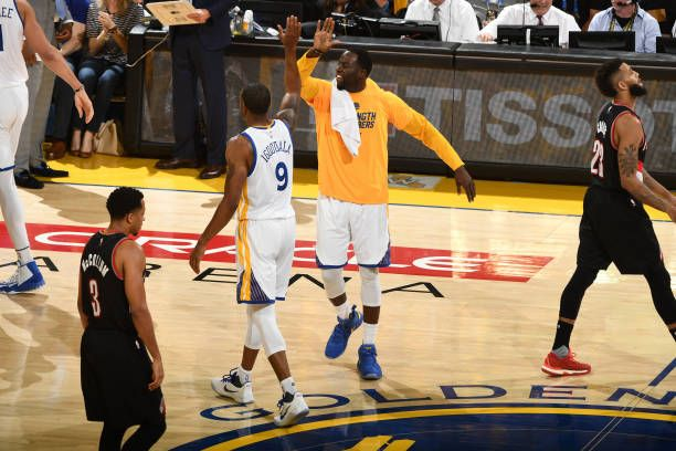 Andre Iguodala and Draymond Green of the Golden State Warriors high five against the Portland Trail Blazers during the Western Conference...