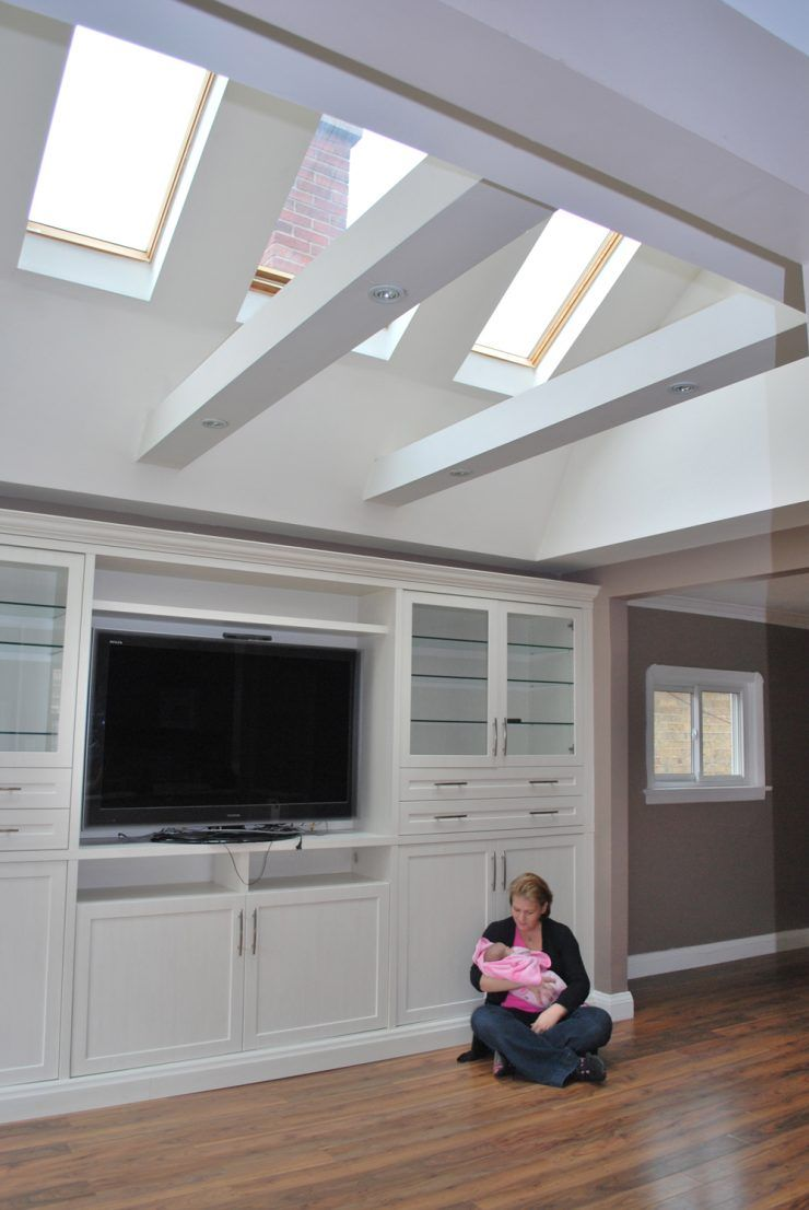 Beautiful skylight addition from flat ceiling and dark ...
