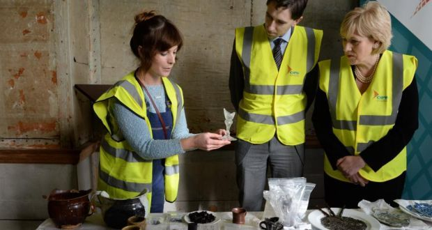 Archaeologist Alva MacGowan showing a part of a 17th century lead crystal glass discovered at Rathfarnham Castle to Minister of State Simon Harris and Minister for Arts, Heritage and the Gaeltacht Heather Humphreys. Photograph: Frank Miller / The Irish Times