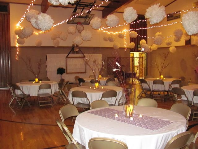 Uses Tissue Paper Balls Lights And Purple Fabric Table Runners