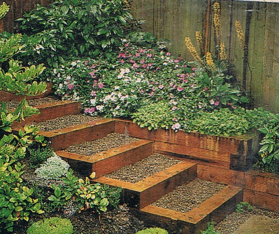 Wood and gravel steps with flower bed. Gravel