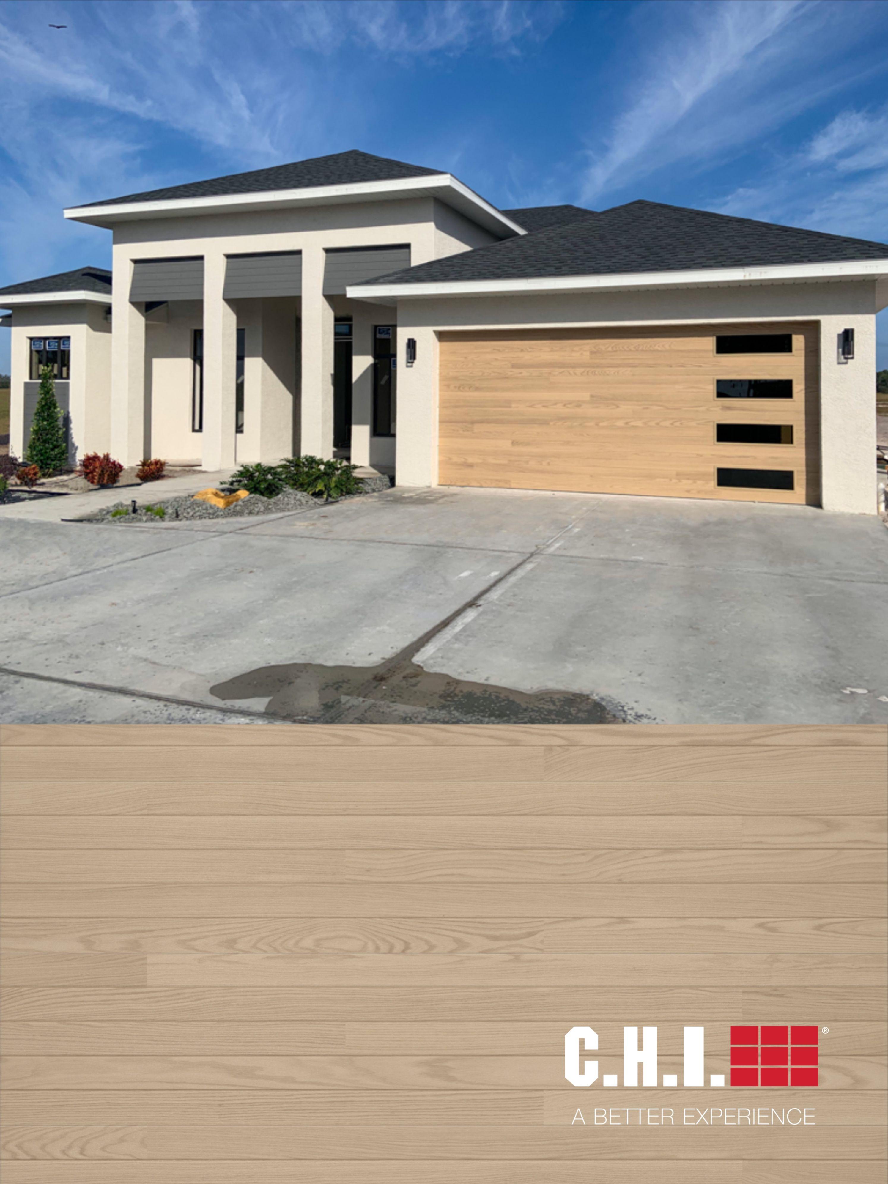 Natural Oak Planks Garage Door On Custom Contemporary Home In 2020 Garage Door Styles Oak Garage Doors Garage Doors