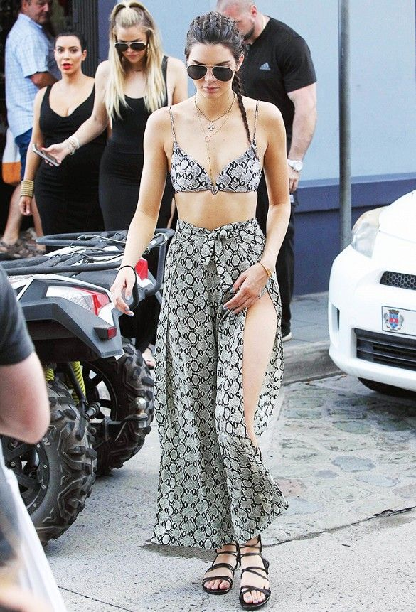 3db7e5b1d8 Kendall Jenner wears a two piece swim set by Zimmermann with layered  jewelry and lace-up sandals