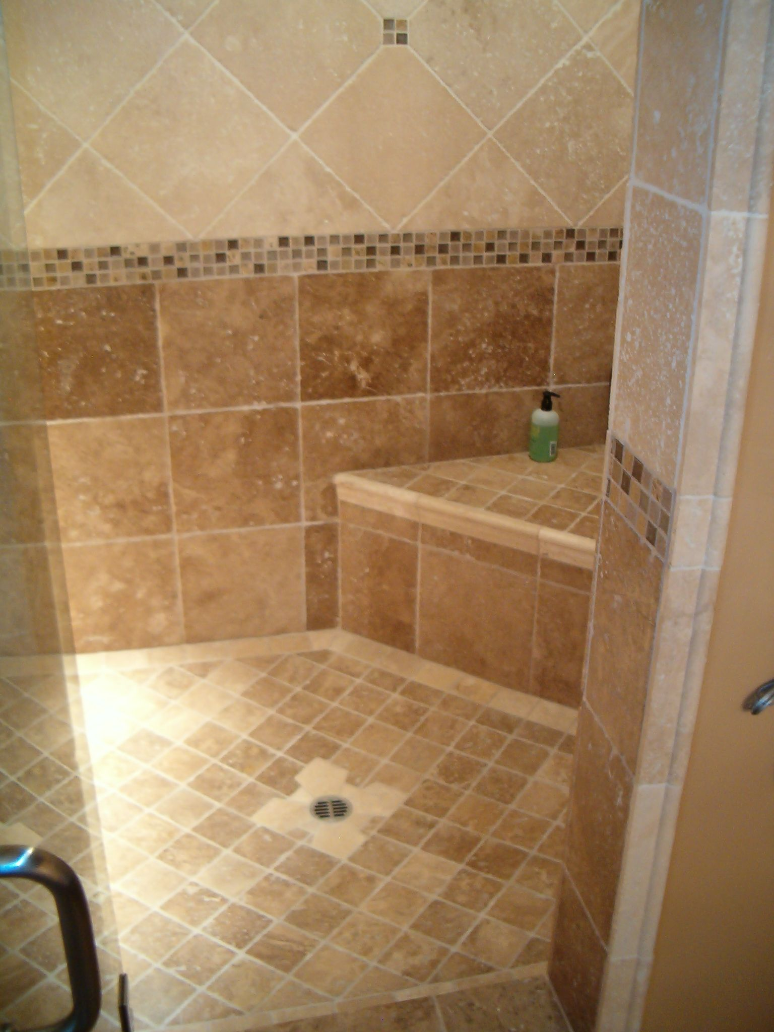 Bathroom tile ideas photos the finished shower is sealed for Tile shower floor ideas