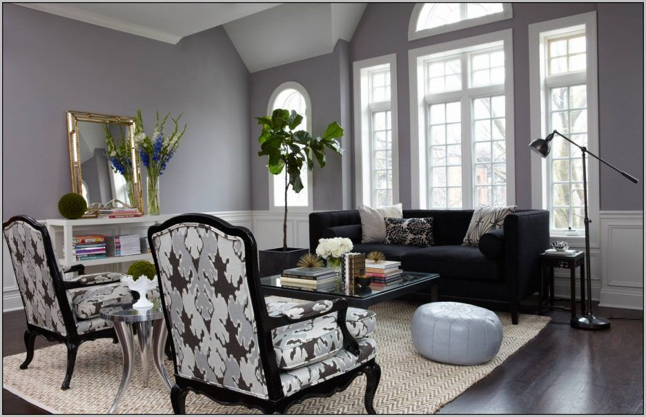 Living Room Warm Gray Paint Colors With Round White Leather Ottoman Also Contemporary Beige Chevron Striped Rug And Black Metal Arc Floor Lamp