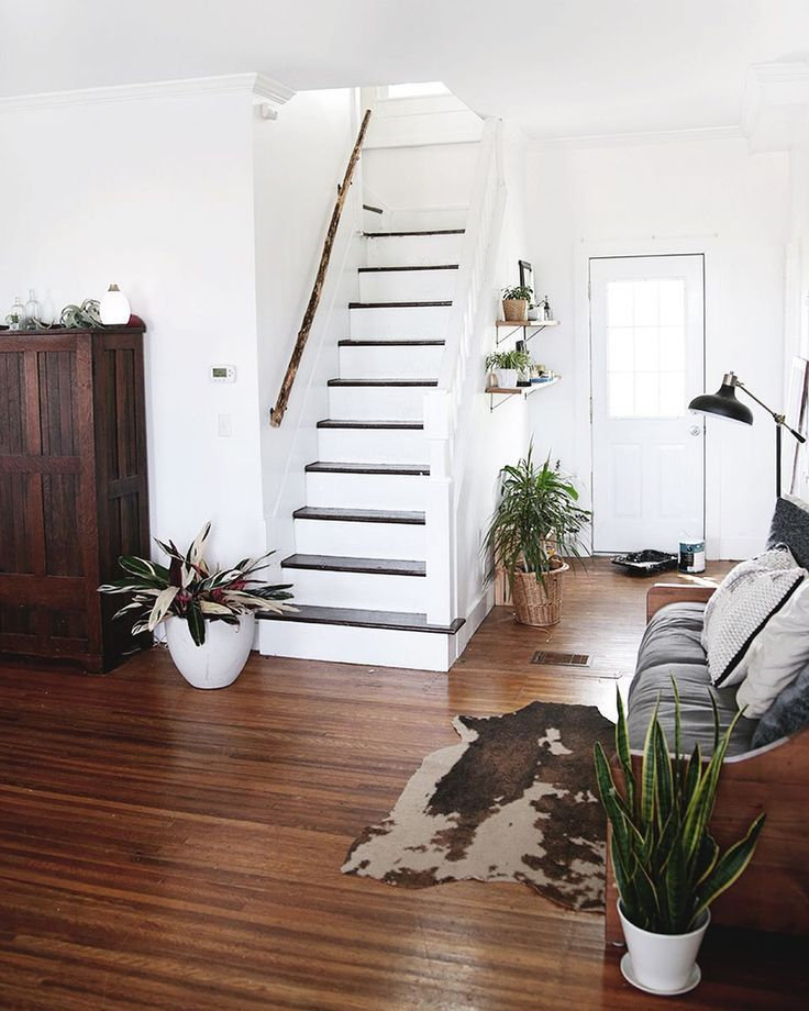 Wood stained stairs rug and plants home entry way in pinterest house decor also rh