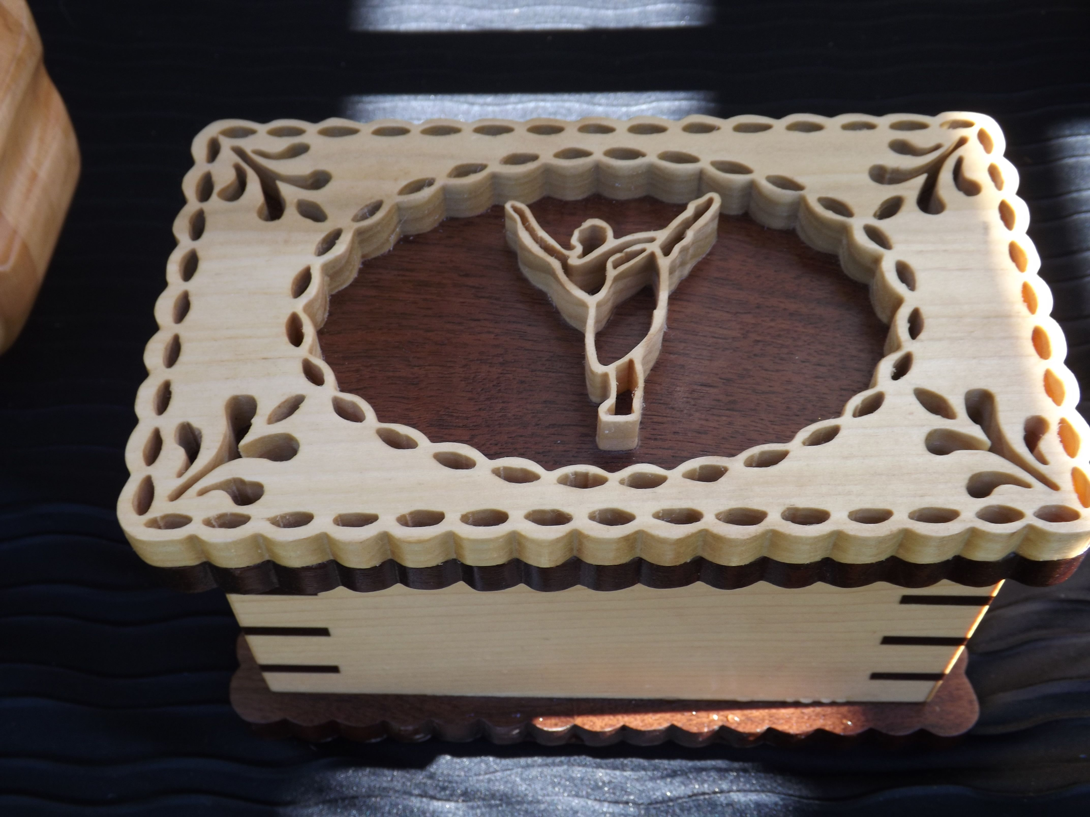 Intricate little girl's jewelry box featuring a scrolled ...