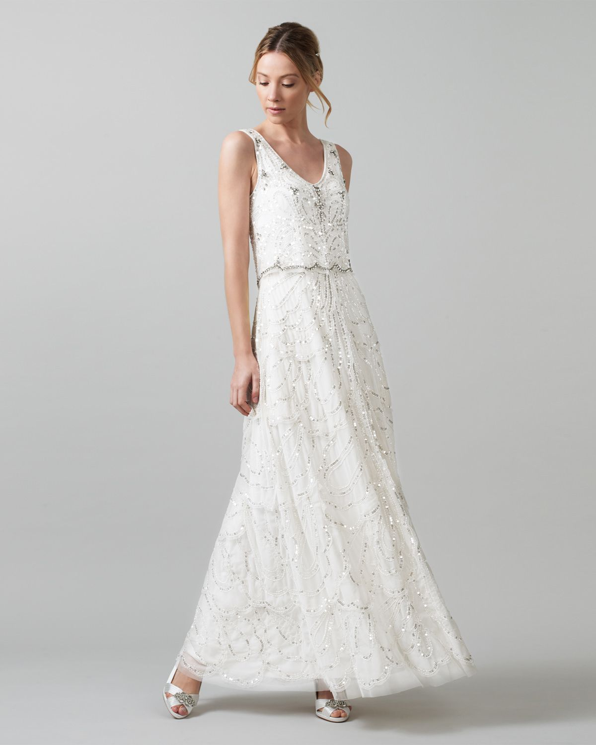 A vintage-inspired fully sequined wedding dress with a layered petal ...