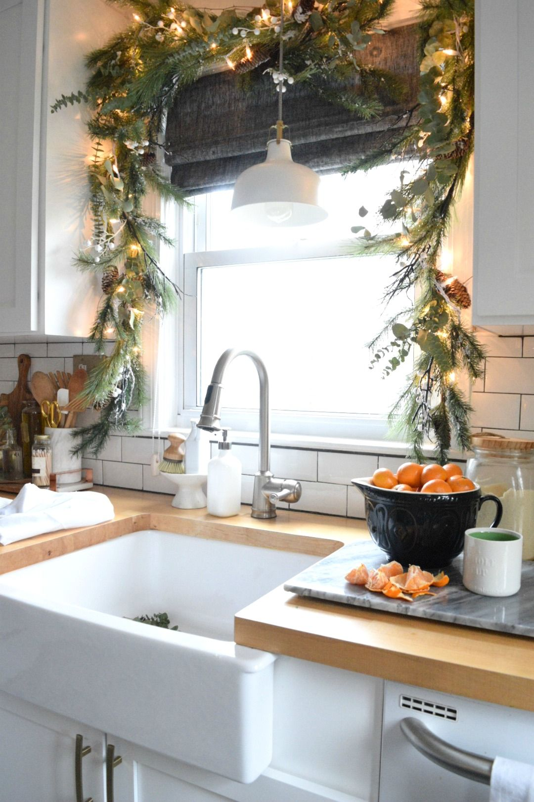 Small window decor  christmas in our small kitchen started with christmas garland
