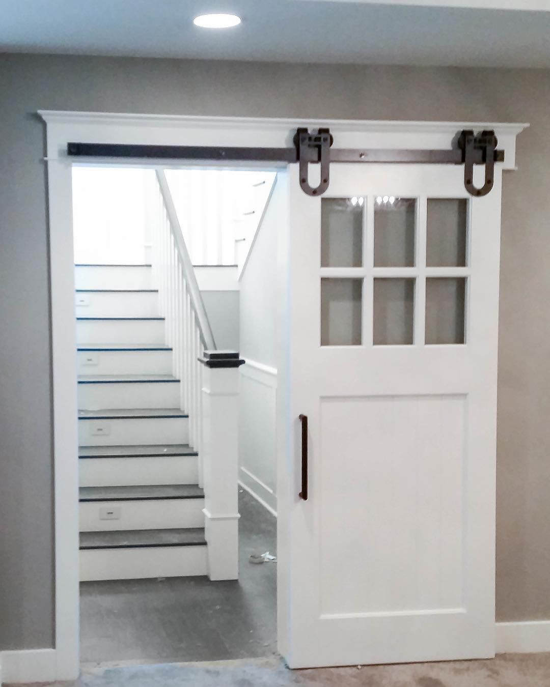 adding the barn door at the bottom of the staircase is a great
