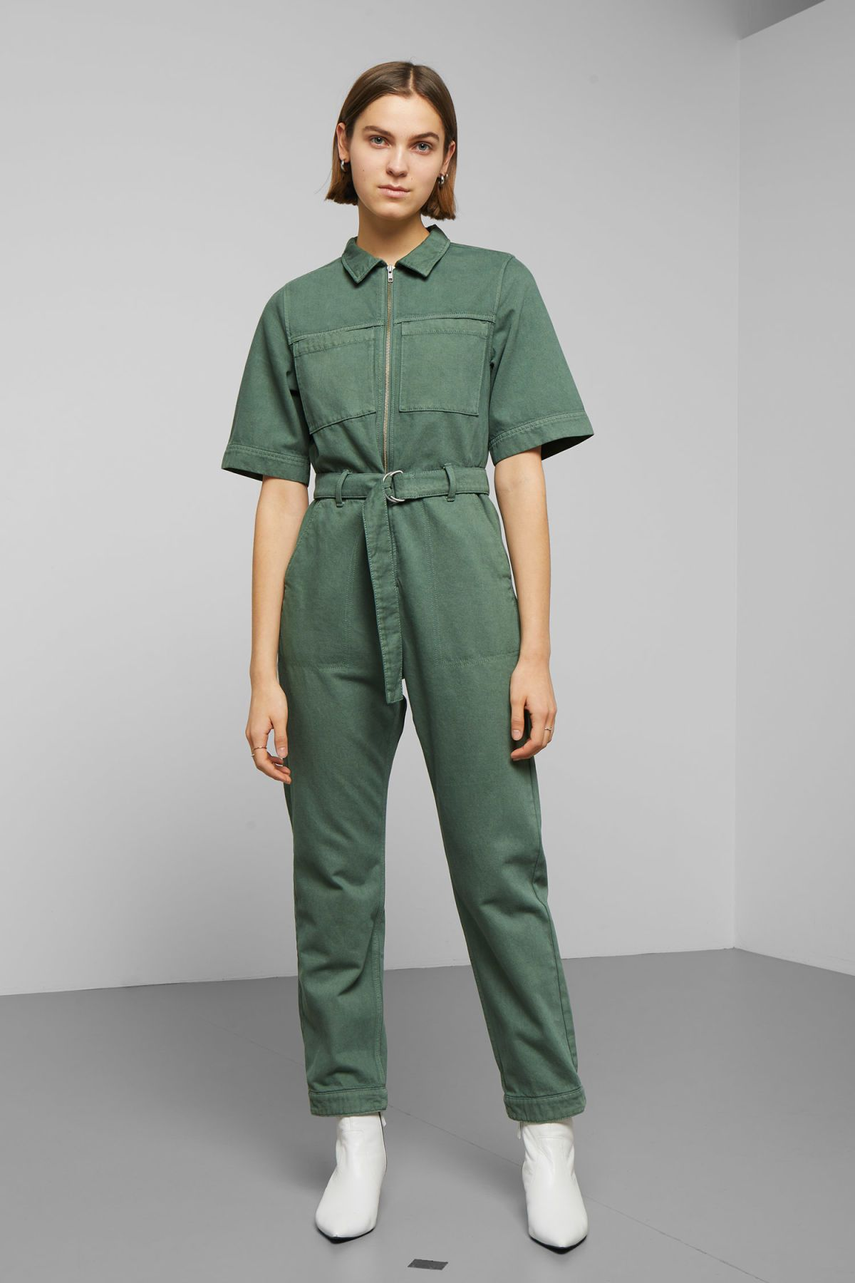 af6f6220a0 Petrol Denim Boiler is a workwear-style jumpsuit cut from rigid organic  cotton in washed green. Designed with straight