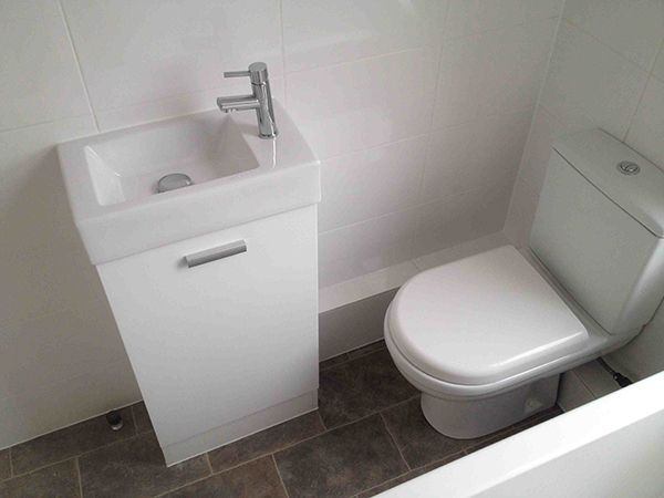 Close Coupled Toilet And Small Basin With Bathroom