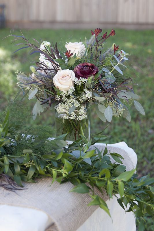 Wedding centerpiece ranunculus winter