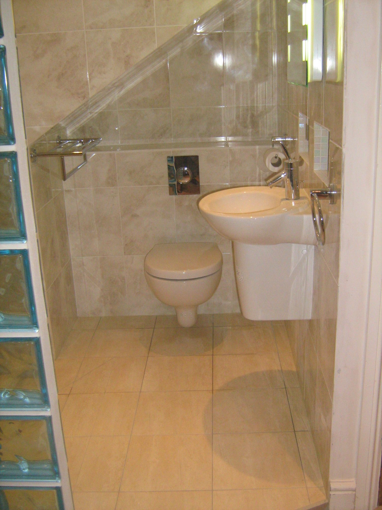 Shower, toilet and sink separated by glass block divider. | Bathroom ...