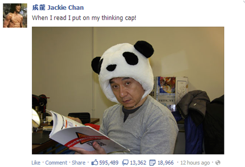 Jackie Chan Reads Wearing A Panda Head Hat Jackie Chan Jackie Celebrities Reading