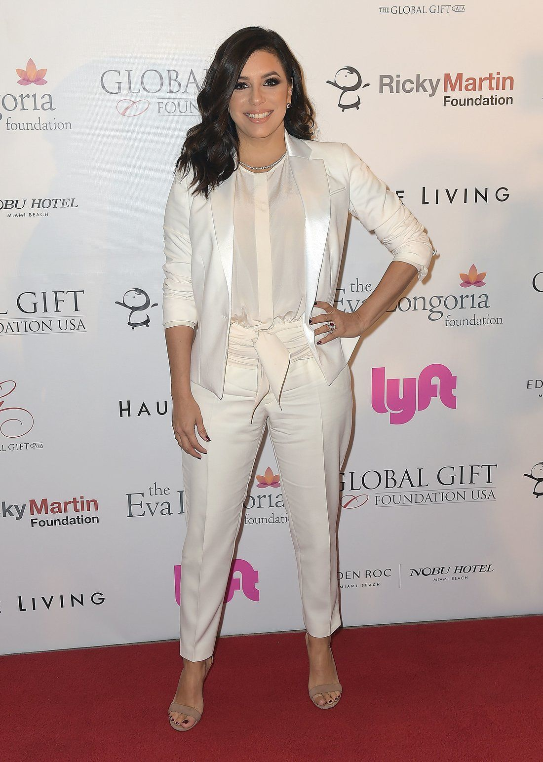 981d76f84ef See Every (Affordable!) Way Eva Longoria Has Been Hiding Her Bump ...