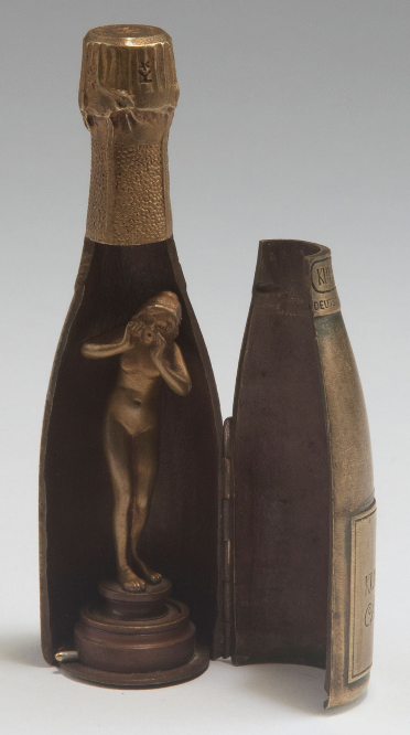 Wiener Bronze. 'Kupferberg Gold' bottle with signet, c1920. Mechanical erotic bronze. H. 12.5 cm. Nude female figure as signet inside. Marked: KUPFERBERG GOLD, Chr. Adt. Kupferberg. Mainz. GEGRÜNDET 1850.