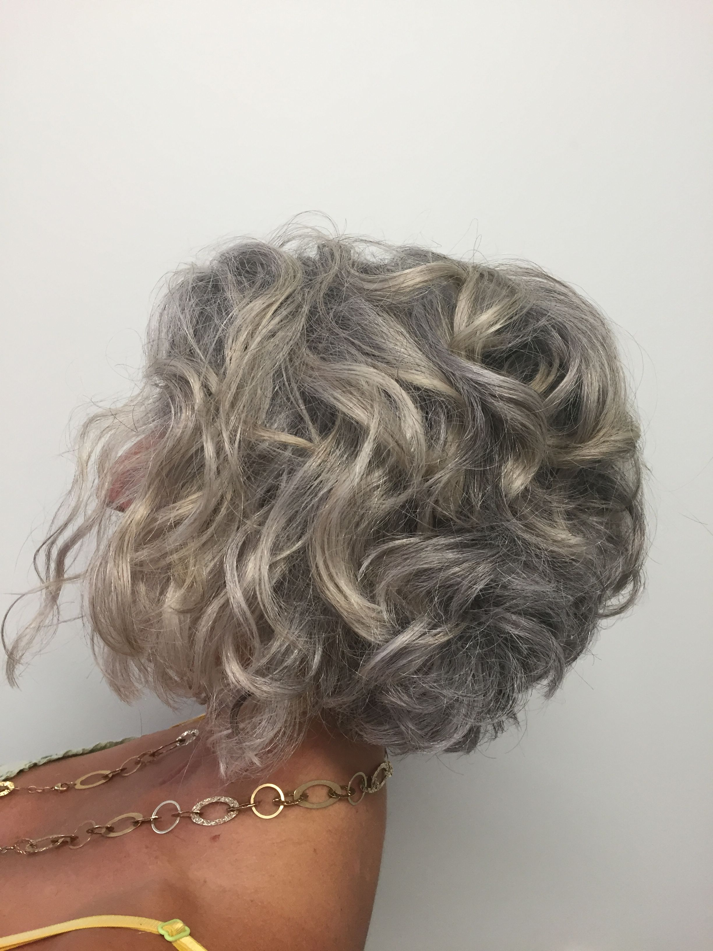 short curly bob. transitioning to grey.   potential hair cut