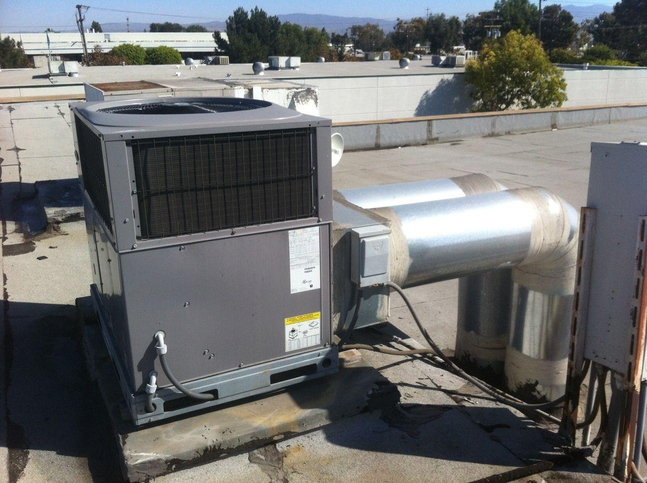 Package Heat Pump installed on roof. Heat pump, Carrier