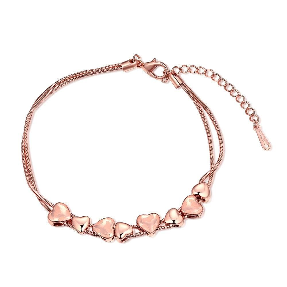 """The adorable String of Hearts Bracelet is the perfect """"I love you"""" gift for that sweet person in your life. It is a high quality jewelry item plated in 18k rose gold. The double strand link chain bracelet is sturdy and durable, secured by a lobster clasp and has an integrated extender. It will fit any sized wrist and desired style. HypoallergenicComfort Fit 14-Day Returns"""
