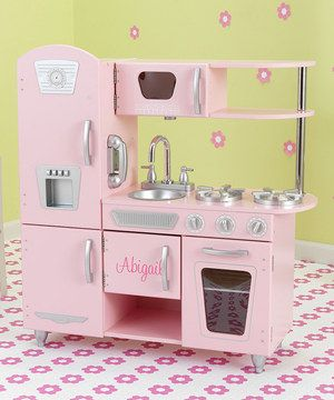 Budding chefs can craft their culinary skills with this vintage-inspired play kitchen. Featuring realistic details including a microwave, sink and refrigerator, this customizable kitchen inspires delightful gourmet meals.