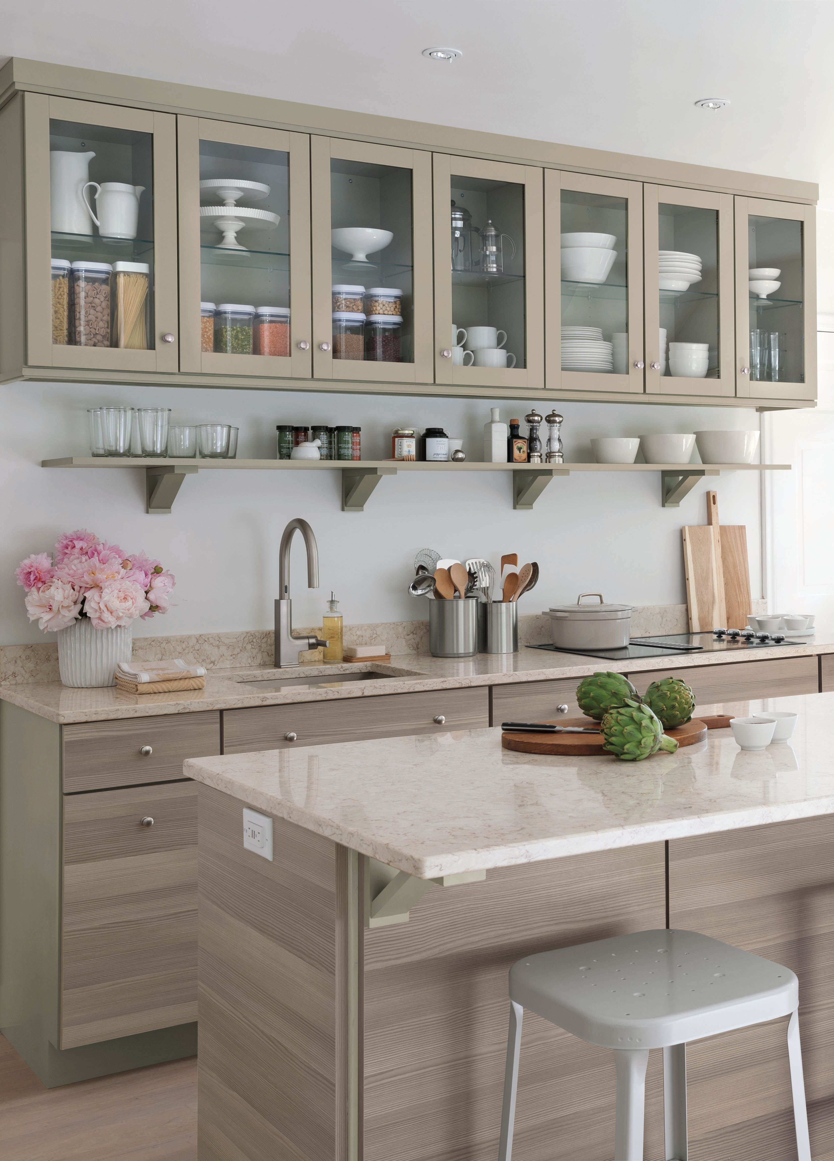 Small Kitchen Design Tip: Hide the refrigerator in the island to expand countertop and cabinet space. Click to learn more design tips and explore Martha Stewart's kitchen renovation.