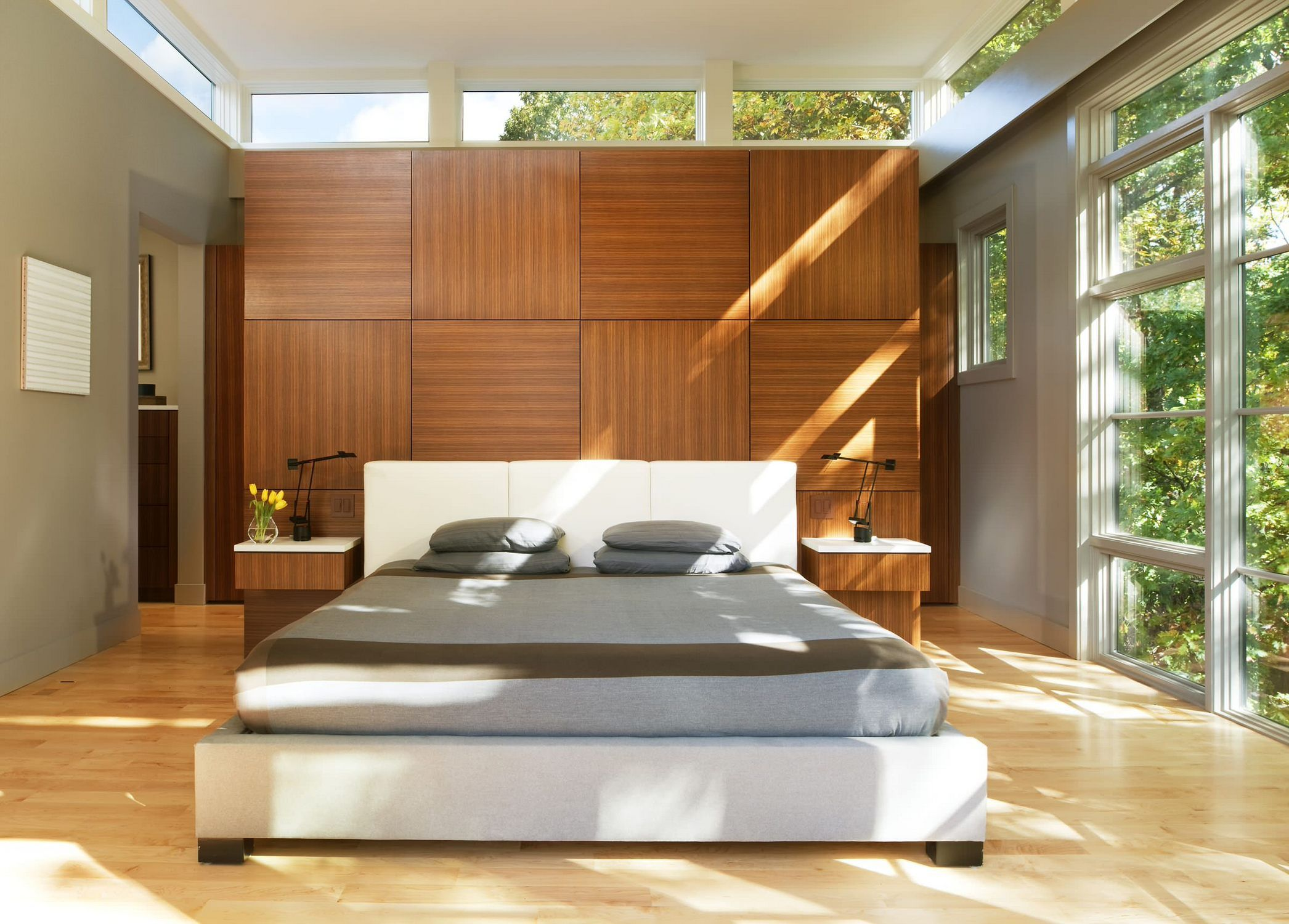 Window above bed ideas  wood paneling behind bed and clerestory windows in the bedroom