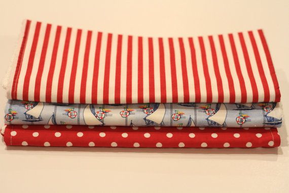 Set of three burp cloths, one striped, one nautical and one polka dot https://www.etsy.com/shop/twomoellers