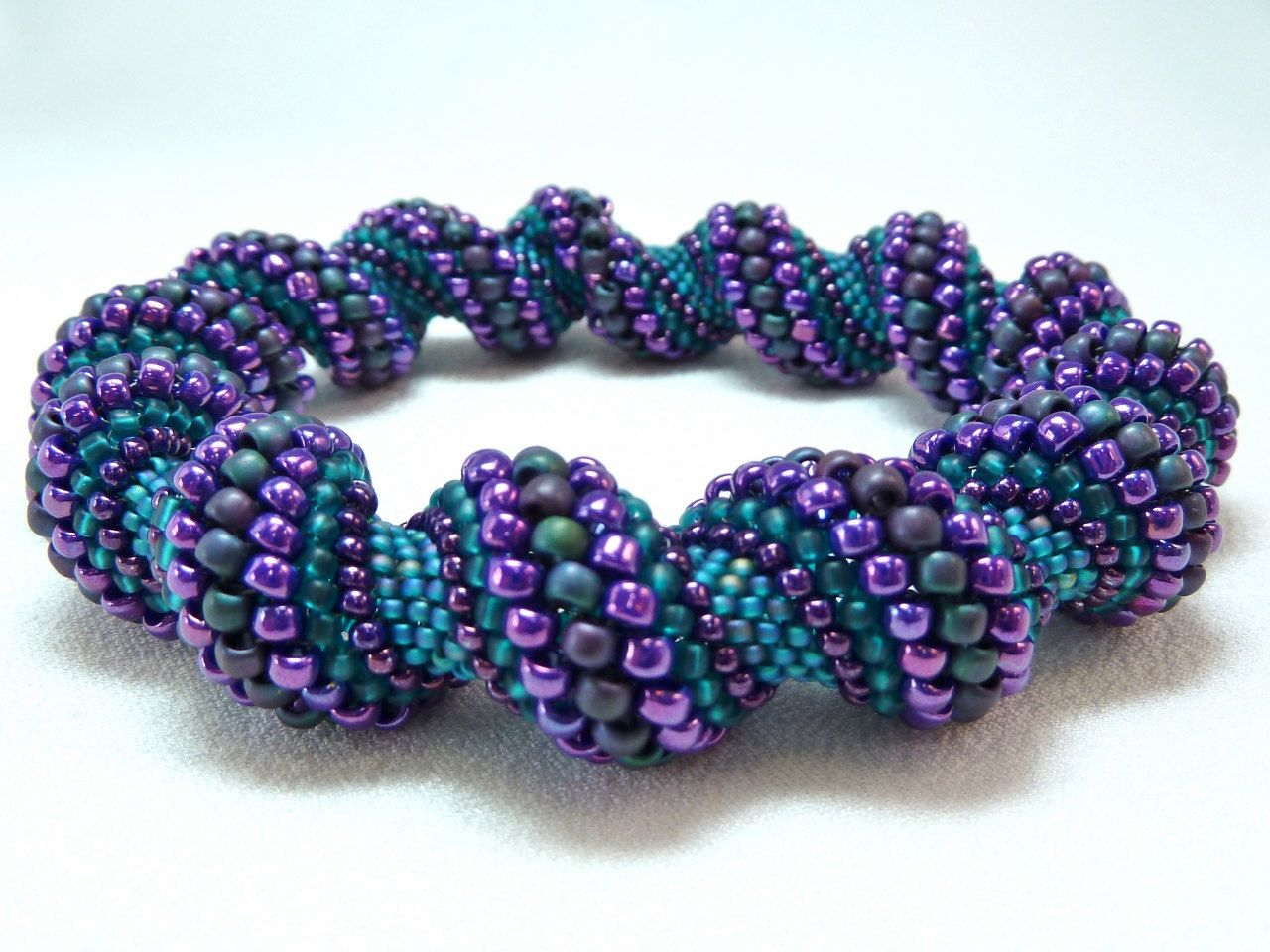Items similar to Deepening Twilight Cellini Spiral Beadwoven Bangle Bracelet - The Twisted Collection on Etsy