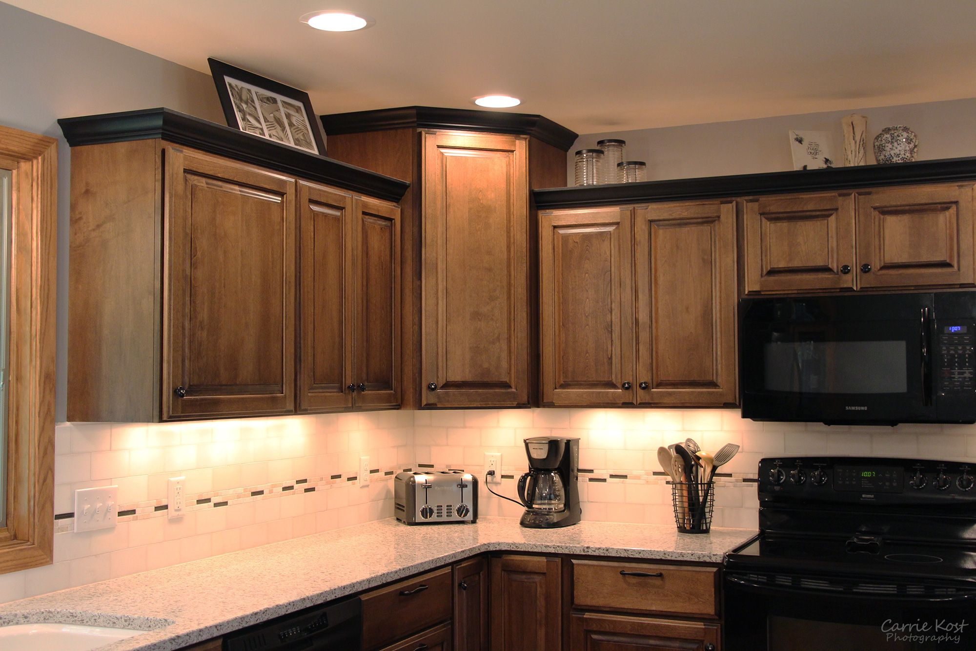 Contrasting Black Crown Molding On The Custom Cabinetry Coordinates With The Homeowners Existin Complete Kitchen Remodel Crown Molding Kitchen Kitchen Remodel