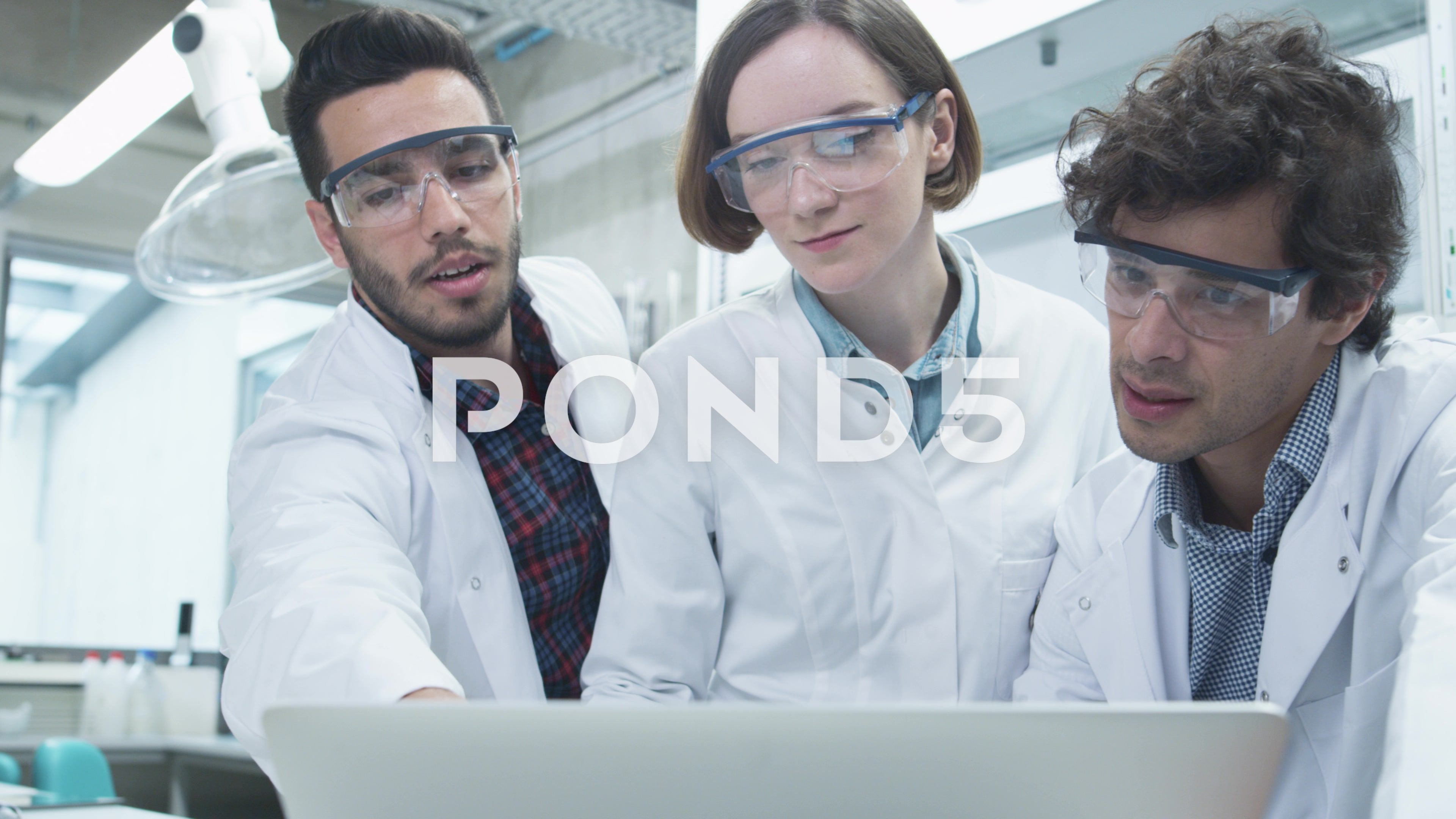 Group Of Multiethnic Students Using Laptop In Laboratory