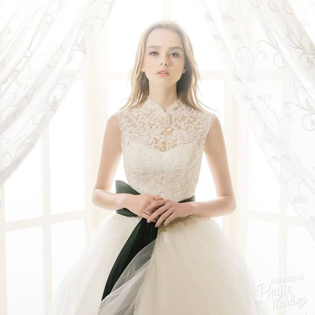 Dreamy laced gown from Beattie Bridal featuring an elegant high-neck design with amazing details!