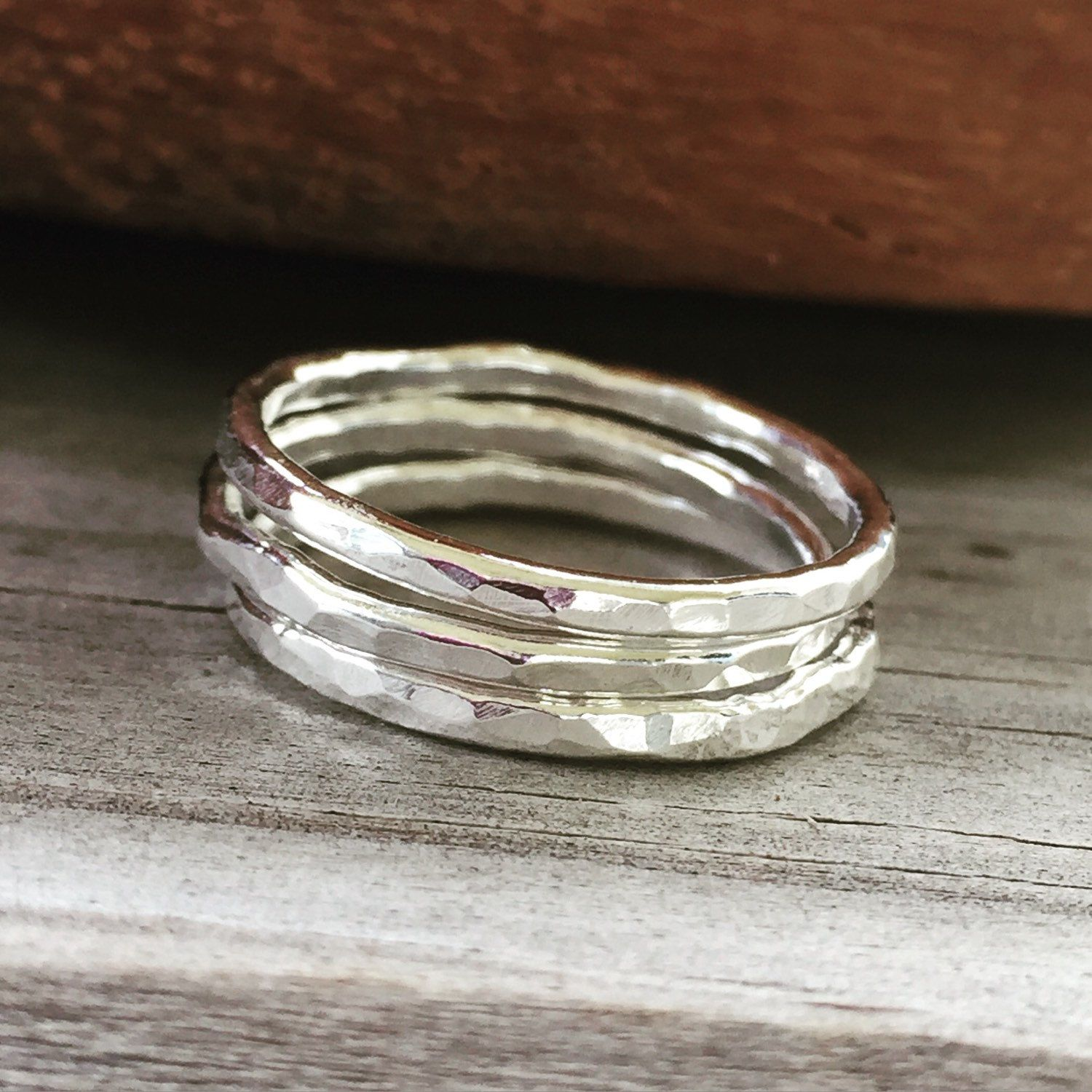 New! Fine Silver (99.9% silver- more precious than Sterling) I've handmade and hand hammered thin stackable rings. Perfect plain or with several stacked together- they are shiny, strong, versatile and comfortable, as well as being very affordable.