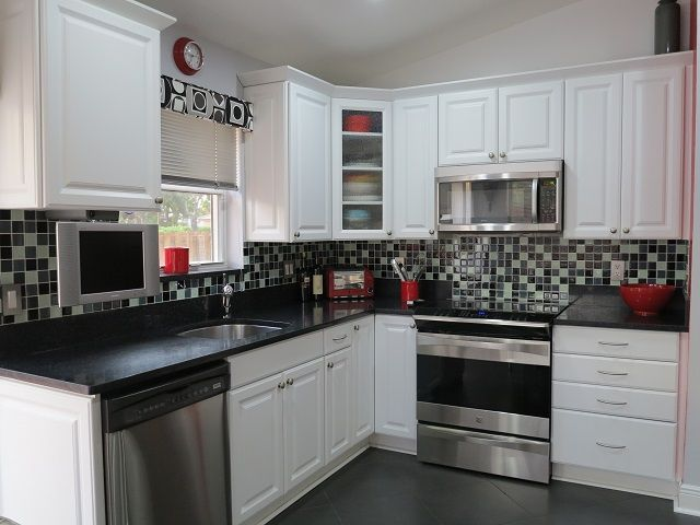 Kitchen has stainless steel dishwasher, oven/stove, microwave ...