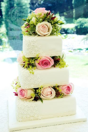 Three Tier Square White Wedding Cake With Roses In Between Tiers
