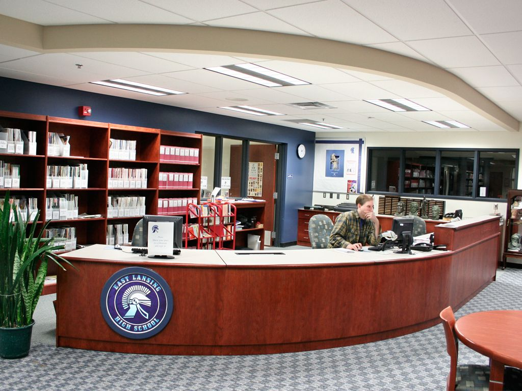 Curved Circulation Desk With Custom Detail