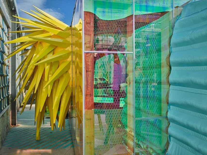 Bureau v adds playful appendages to mini living urban cabin study