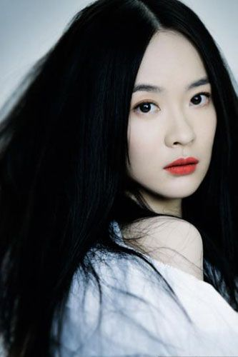 Woman With Long Straight Black Hair Pale Skin And Bright Red