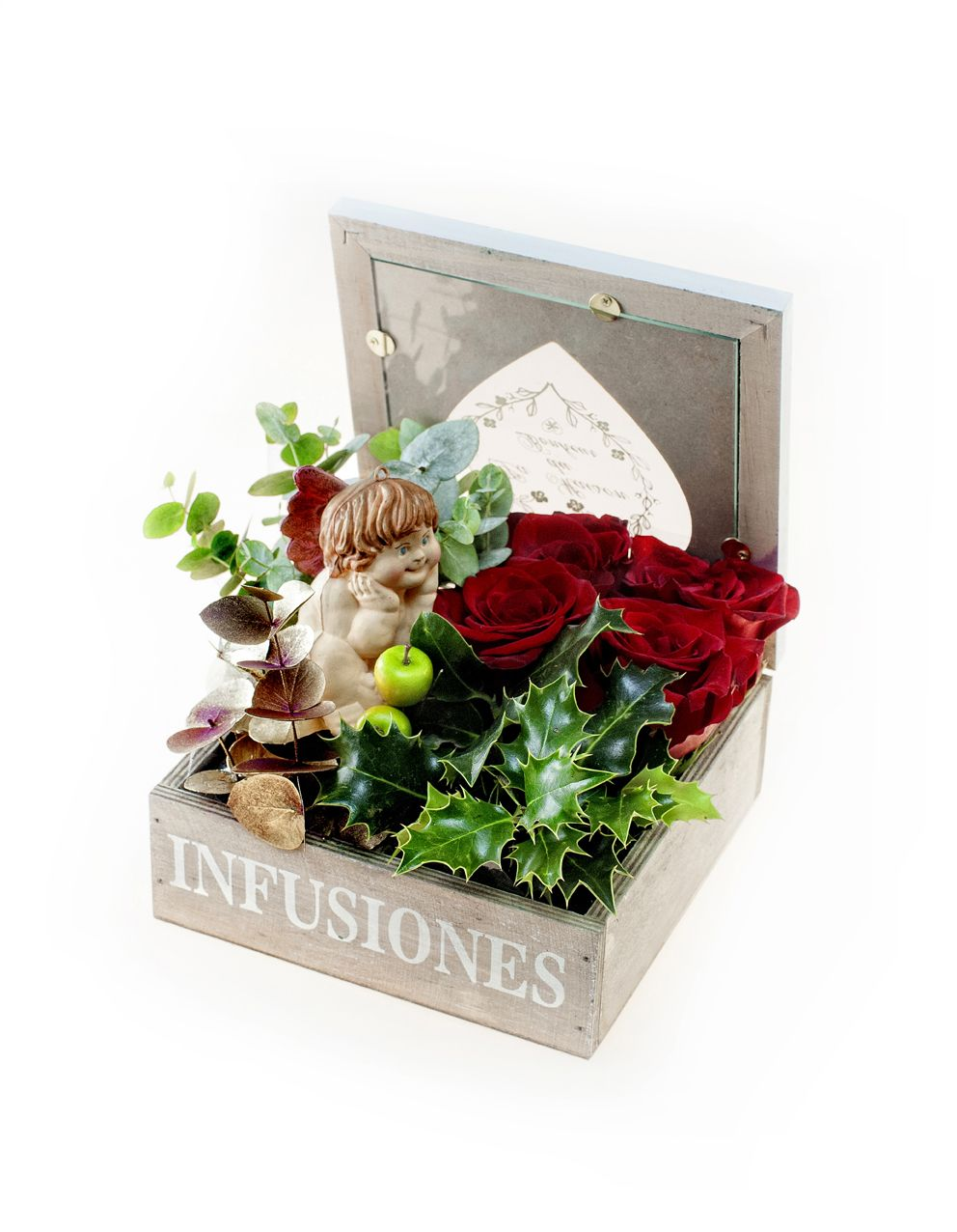 www.carolinabouquet.com caja de madera con tapa de cristal,forma de corazón.Con 4 departamentos con rosas naturales y verdes navideños varios. pick de angelote
