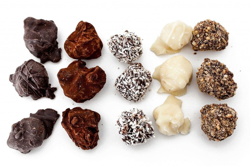 xox truffles on a white marble slab truffles food