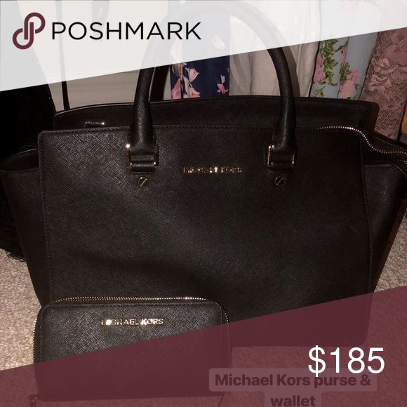 22be8bcebee8f2 Michael Kors large black purse Used only twice! Purse and wallet are a set  and I want to sell them together! Black & gold Has a strap and can be used  as ...