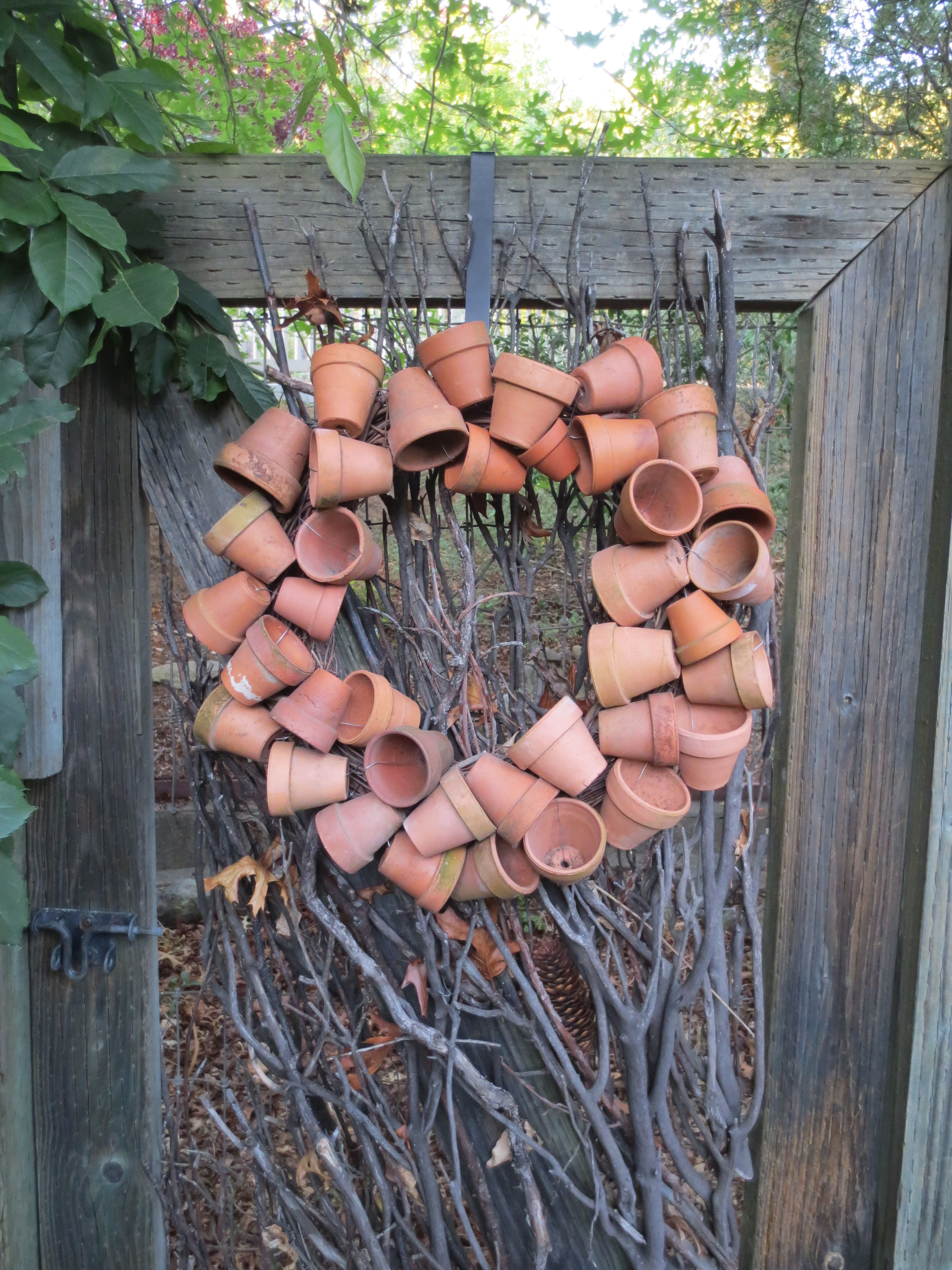 Clay pot wreath on branches