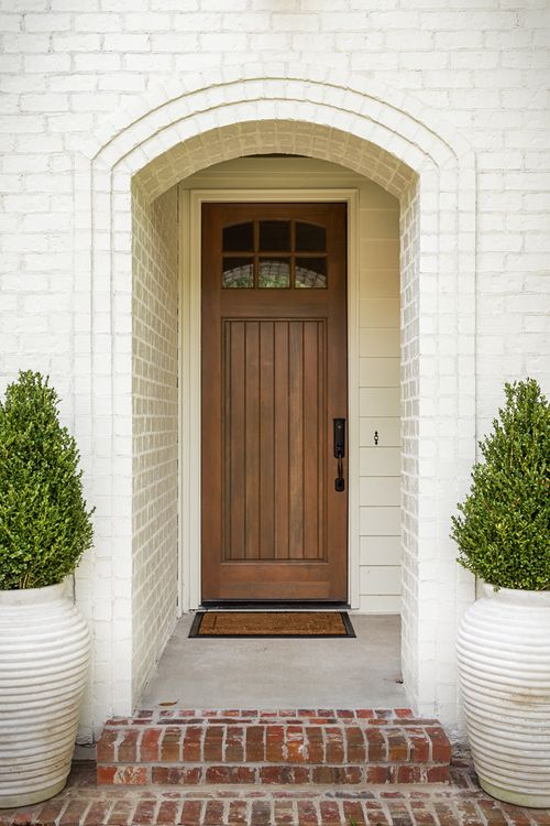 Love The Wood Door White Brick Exterior And Red Brick
